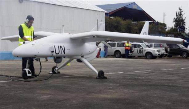 A technician checks a surveillance Unmanned Aerial Vehicles (UAV) drone operated by the United Nations in Goma